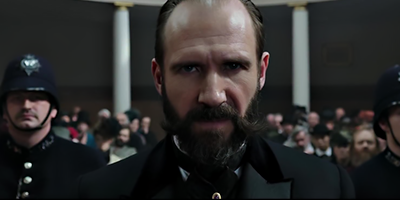 Holmes & Watson Ralph Fiennes.png
